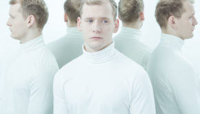 54146103 - sick, young man with split personality standing in white interior